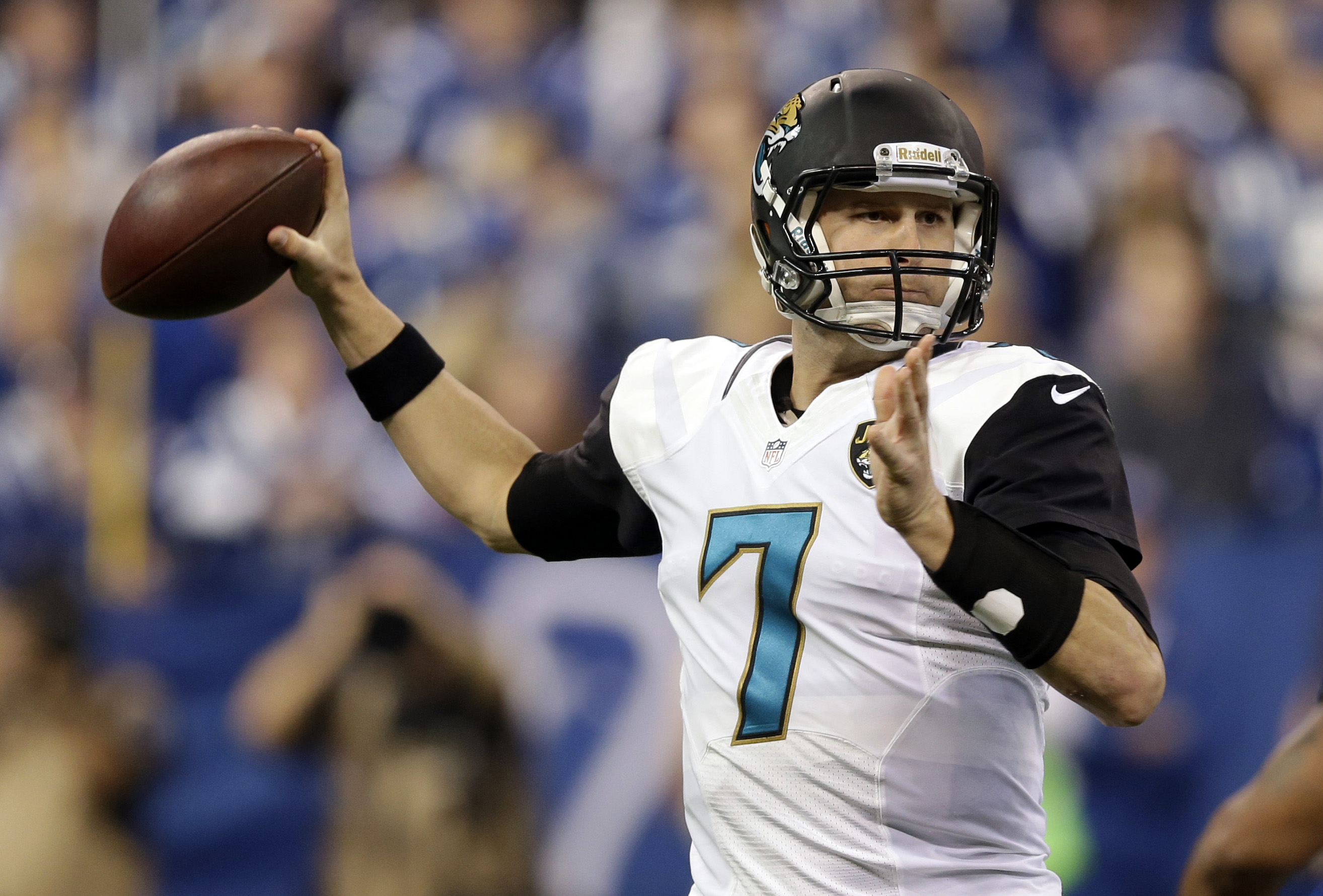 Jacksonville Jaguars' Chad Henne (7) throws during the first half of an NFL football game against the Indianapolis Colts, Sunday, Dec. 29, 2013, in Indianapolis