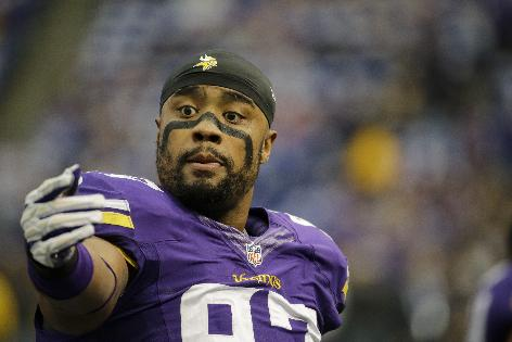 Minnesota Vikings defensive end Everson Griffen walks off the field before an NFL football game against the Philadelphia Eagles, Sunday, Dec. 15, 2013, in Minneapolis