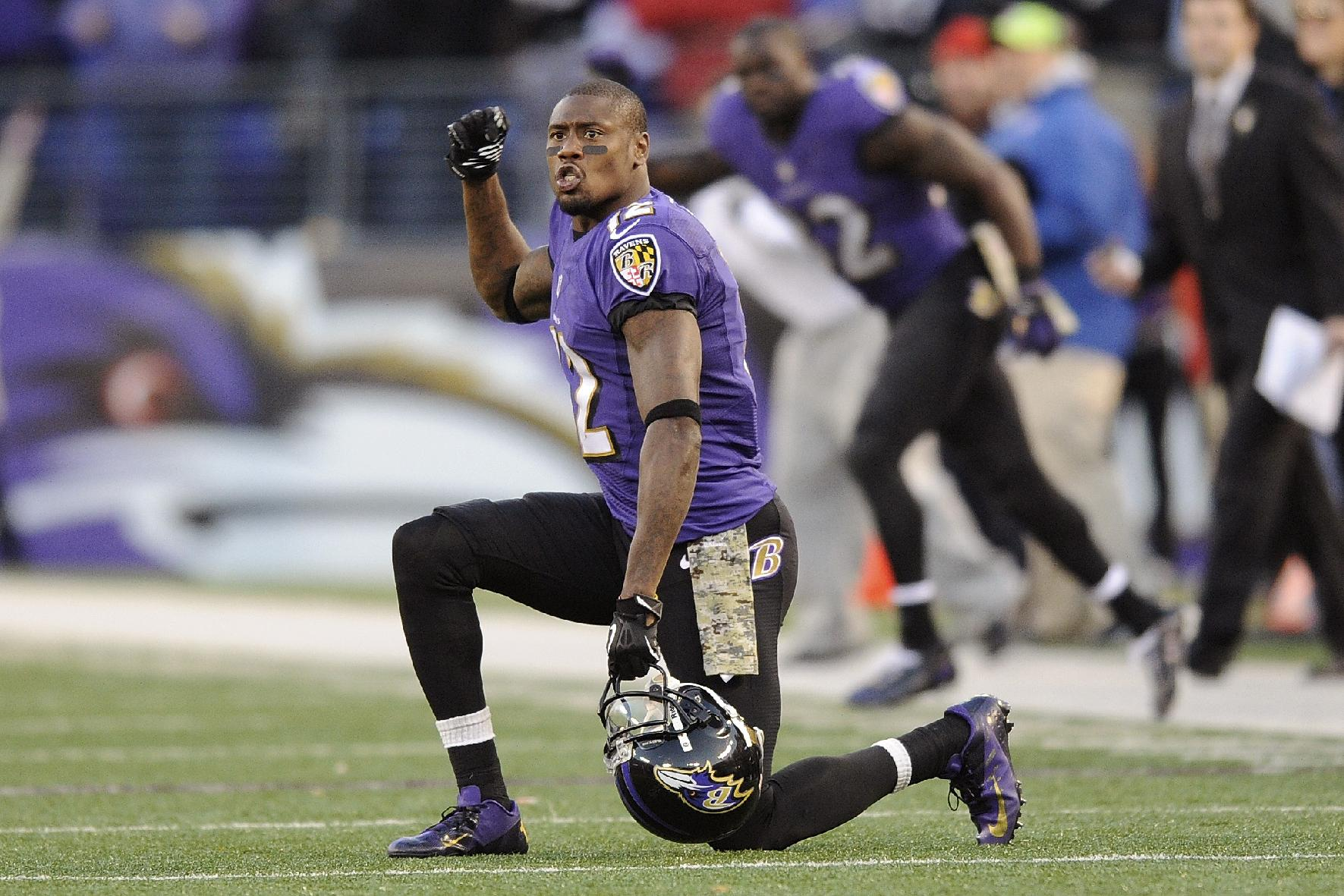 In this Nov. 10, 2013 file photo, Baltimore Ravens wide receiver Jacoby Jones cheers as Justin Tucker's kick clears the goalposts for a field goal giving the Ravens a 20-17 victory over the Cincinnati Bengals in overtime in a NFL football game in Baltimore. The Ravens and Jones agreed on a four-year contract Wednesday, March 12, 2014, after he drew interest from other teams as a free agent