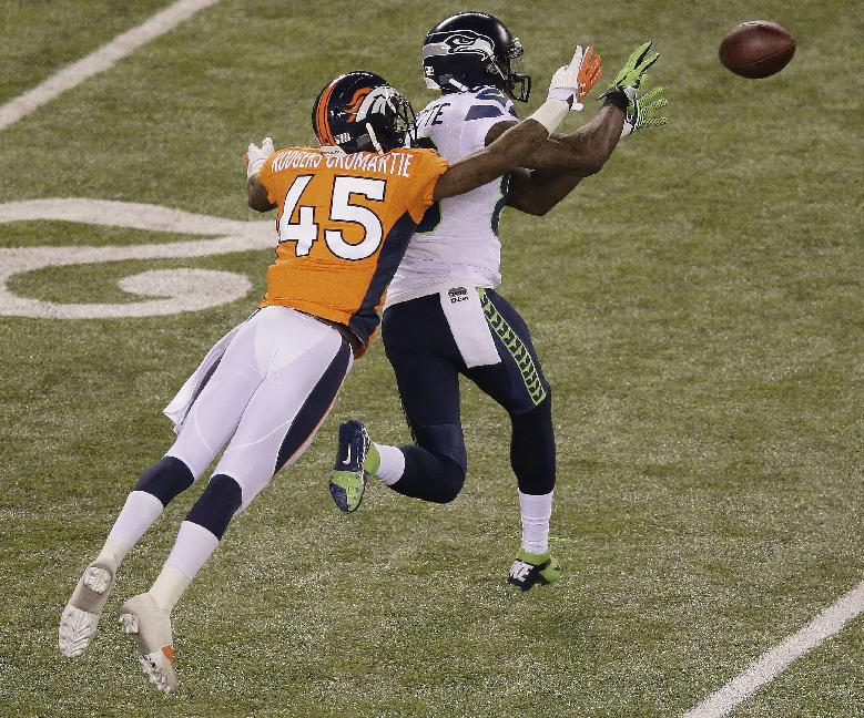 Seattle Seahawks' Ricardo Lockette prepares to make a catch against Denver Broncos' Dominique Rodgers-Cromartie during the second half of the NFL Super Bowl XLVIII football game Sunday, Feb. 2, 2014, in East Rutherford, N.J. Lockette scored a touchdown on the play