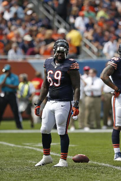Chicago Bears defensive tackle Henry Melton (69) waits for a play during the first half of an NFL football game against the Cincinnati Bengals Sunday, Sept. 8, 2013, in Chicago