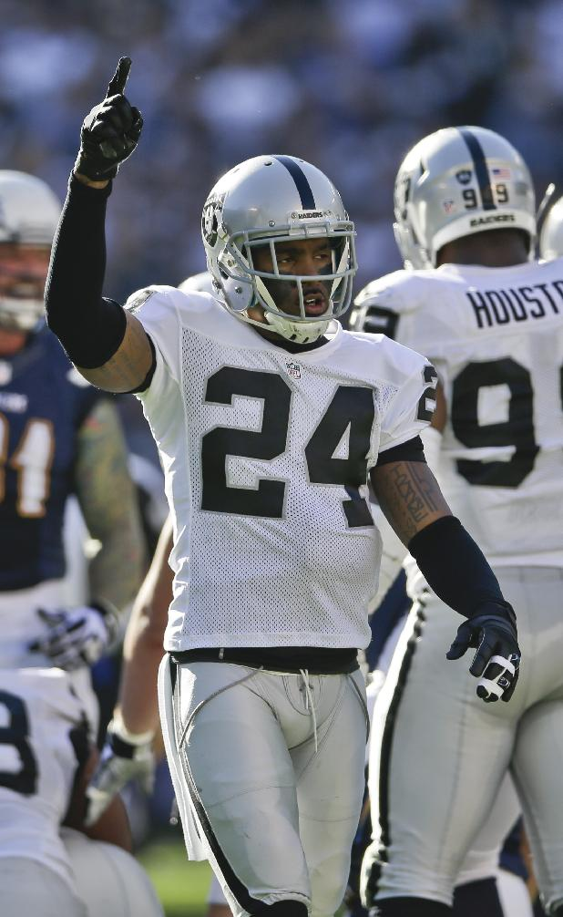 Oakland Raiders free safety Charles Woodson celebrates a Raiders' fumble recovery during the first half of an NFL football game against the San Diego Chargers on Sunday, Dec. 22, 2013, in San Diego, CA