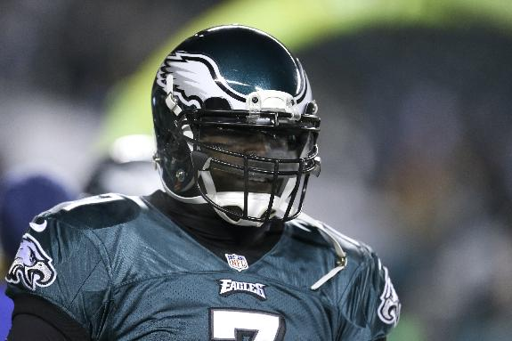 Philadelphia Eagles' Michael Vick warms up before an NFL wild-card playoff football game against the New Orleans Saints, Saturday, Jan. 4, 2014, in Philadelphia