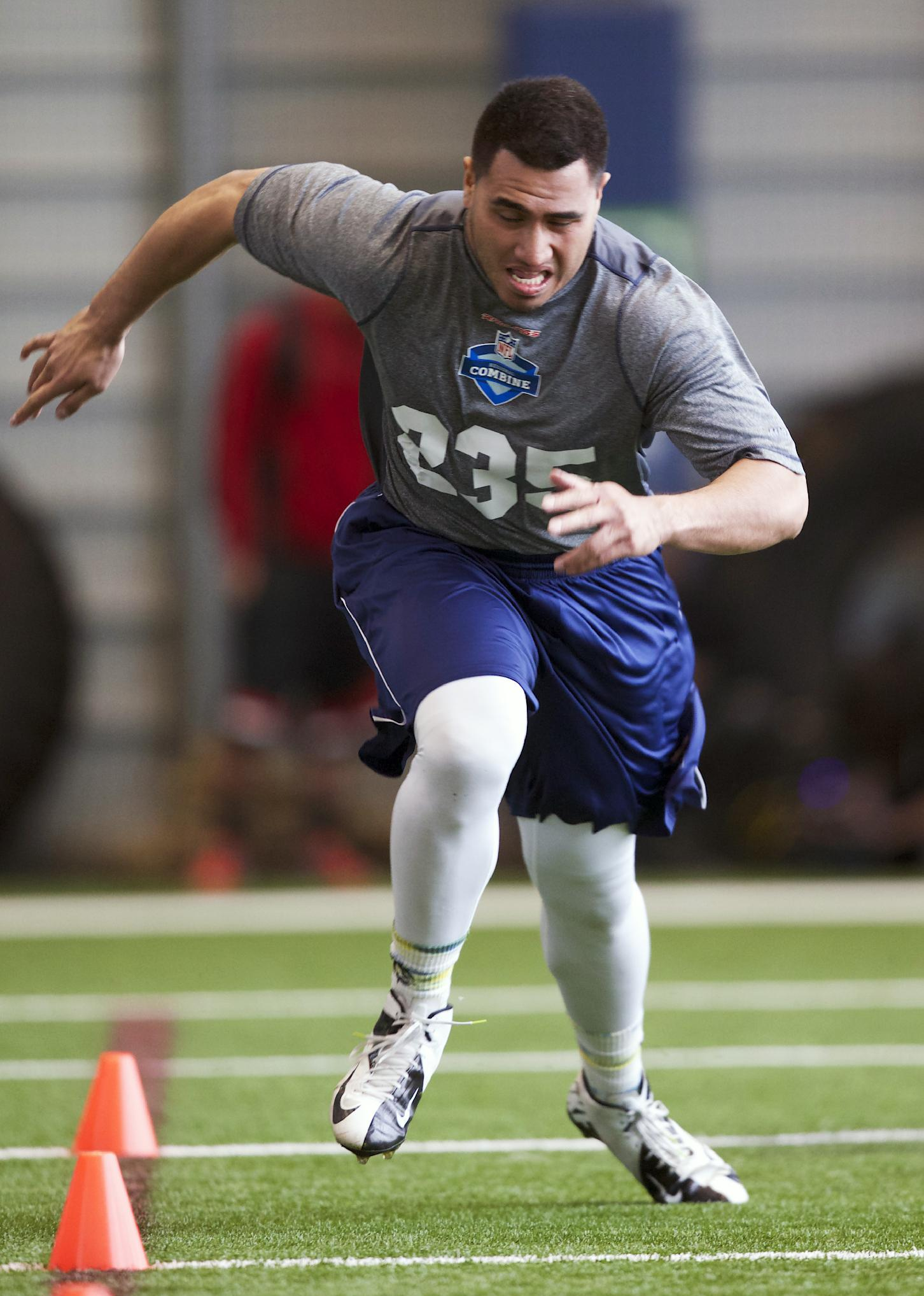 BYU running back Harvey Unga runs to the finish of the short shuttle drill Saturday, March 22, 2014, during practice drills at an NFL football regional combine in Renton, Wash