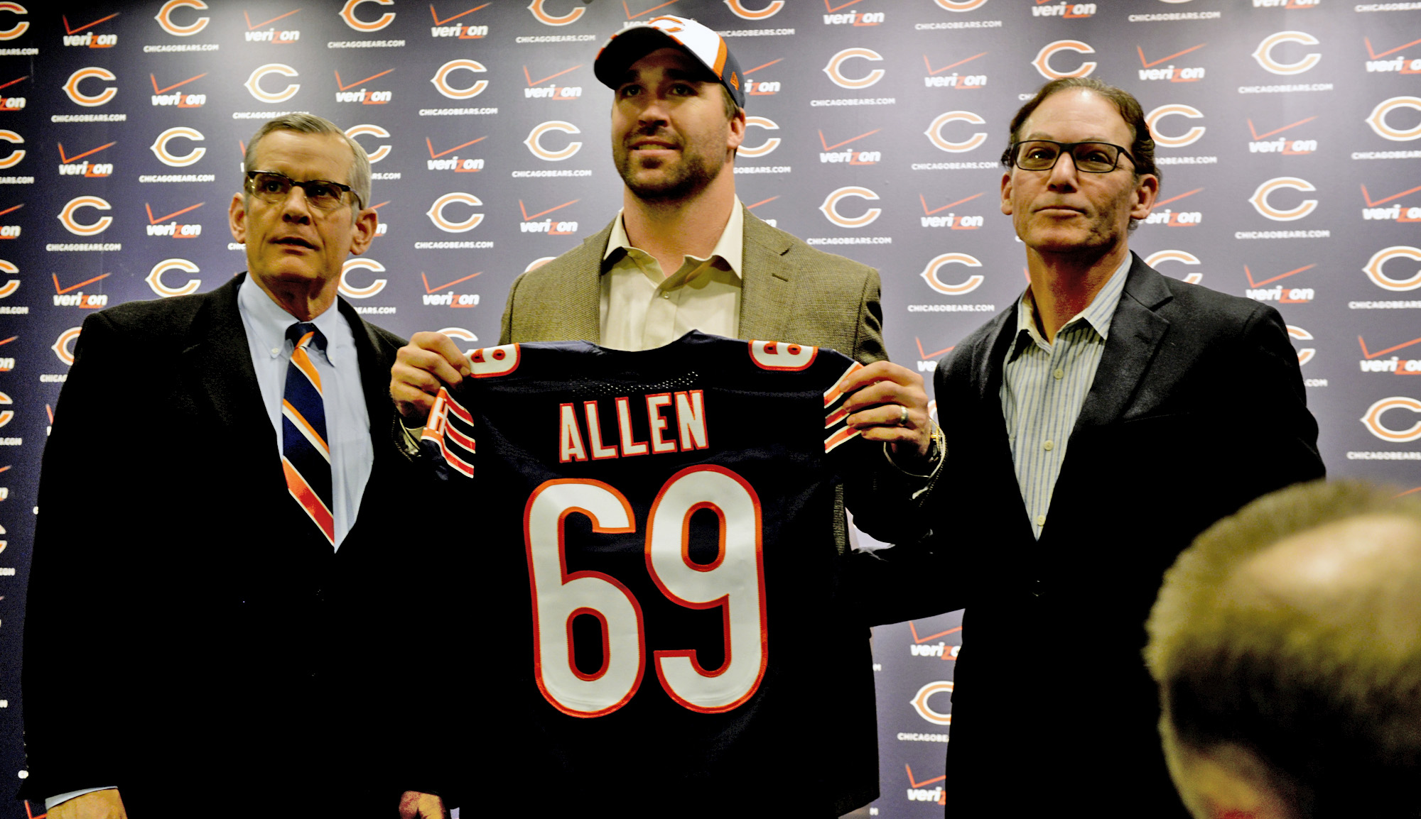 Chicago Bears general manager Phil Emery, left, poses for a photo with new Bears NFL football player Jared Allen, center, and his agent Ken Harris at a news conference where Allen was introduced Monday, March 31, 2014, in Lake Forest, Ill