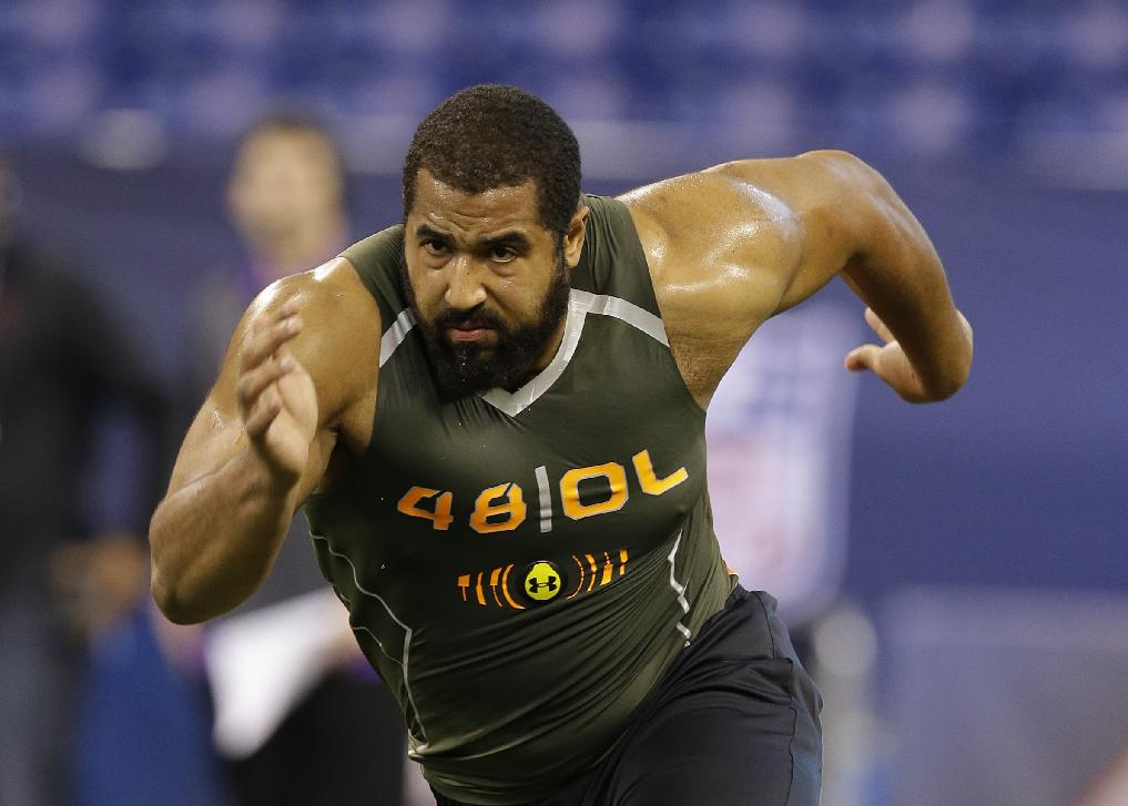 In this Feb. 22, 2014 file photo, Penn State offensive lineman John Urschel runs a drill at the NFL football scouting combine in Indianapolis. Urschel will routinely provide a look at his journey leading to the NFL draft on May 8 in a series of diary entries