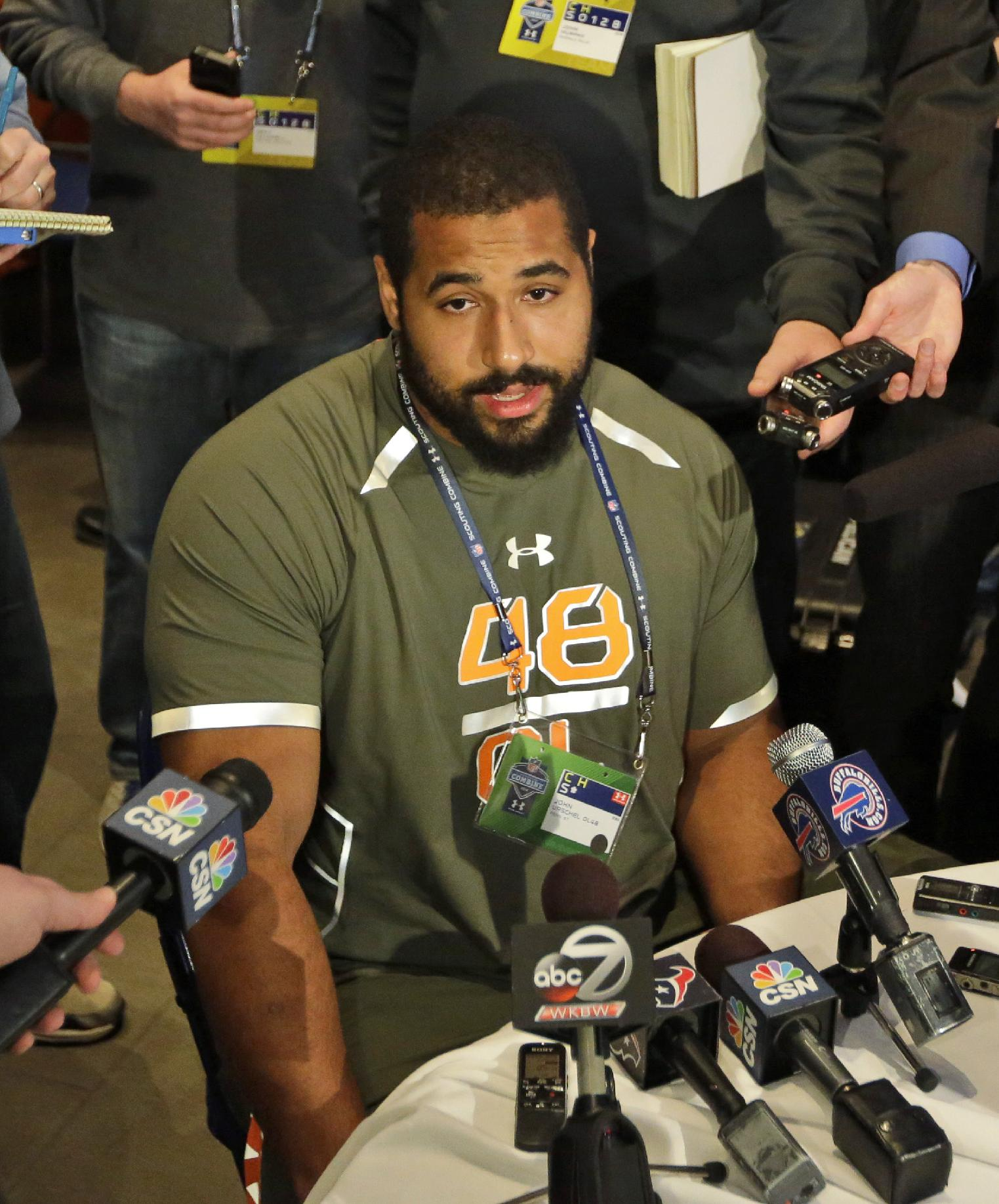 In this Feb. 20, 2014 file photo, Penn State offensive lineman John Urschel answers a question during a news conference at the NFL football scouting combine in Indianapolis. Urschel will routinely provide a look at his journey leading to the NFL draft on May 8 in a series of diary entries