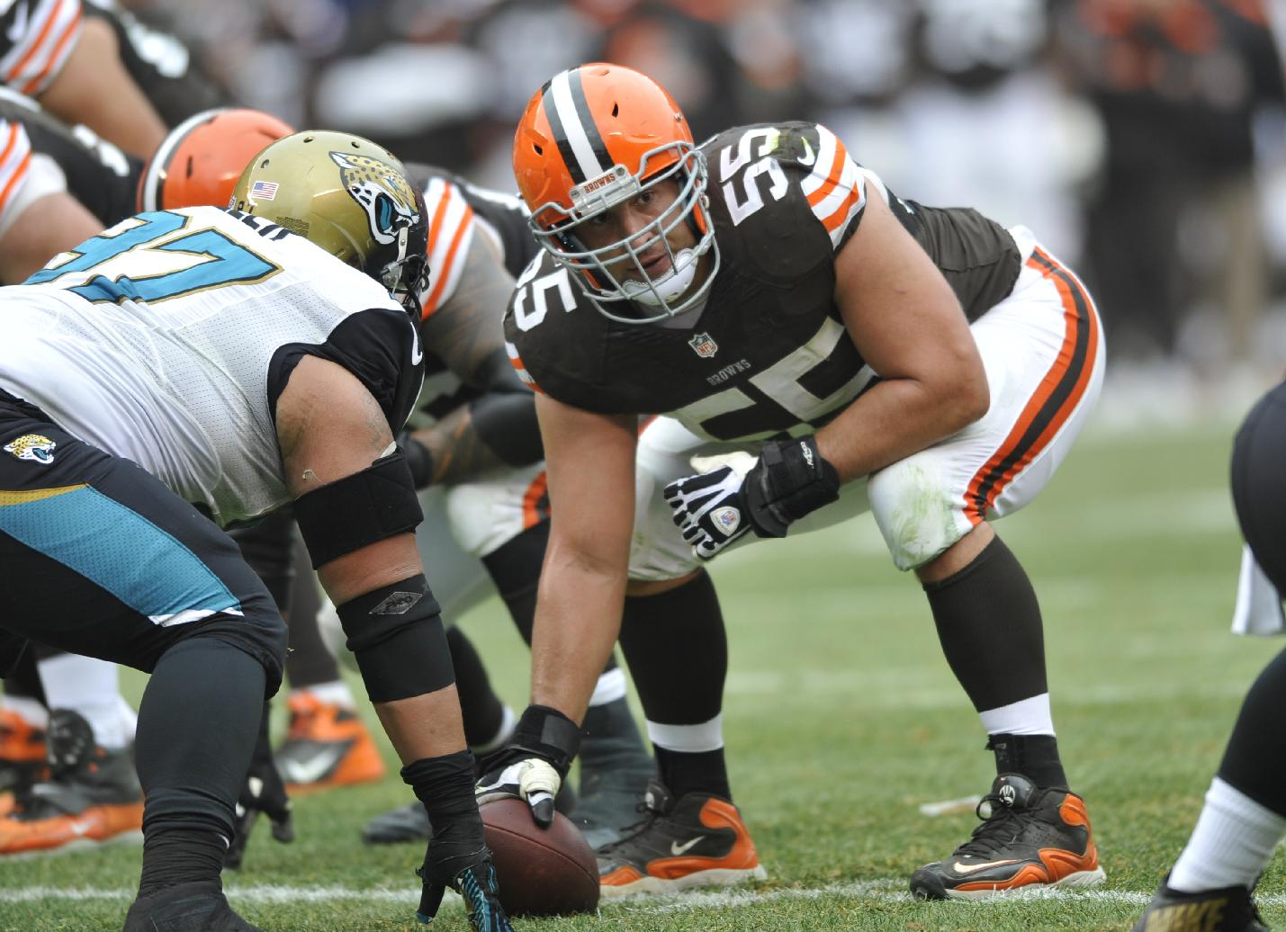 This Dec. 1, 2013 file photo shows Cleveland Browns center Alex Mack (55) in action during an NFL football game against the Jacksonville Jaguars, in Cleveland. Browns Pro Bowl center Alex Mack's football future could be decided in the next few days _ or hours. The Jacksonville Jaguars are expected to sign Mack to a contract offer sheet on Friday, April 11, 2014. Once the paperwork is filed, the Browns will have five days to match. Cleveland secured that right after placing a $10 million transition tag on Mack before free agency opened