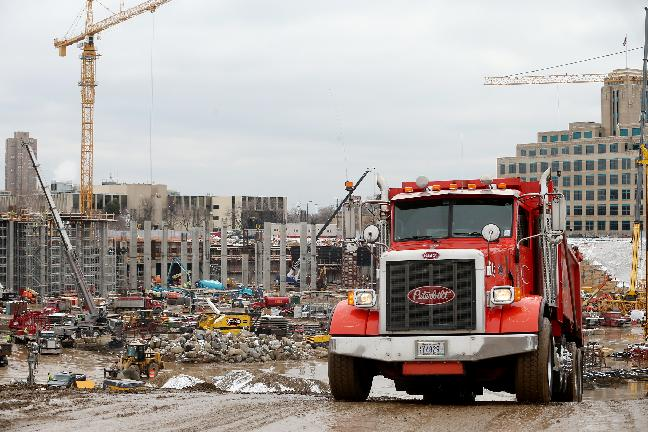 A truckload of debris is removed from the Metrodome demolition site in Minneapolis, Thursday, April 17, 2014. Project leaders for the new Minnesota Vikings stadium says the demolition of the team's old home was formally completed Thursday