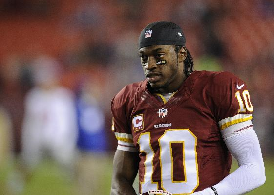 Washington Redskins quarterback Robert Griffin III (10) looks on during warm ups before an NFL football game against the New York Giants, Sunday, Dec. 1, 2013, in Landover, Md