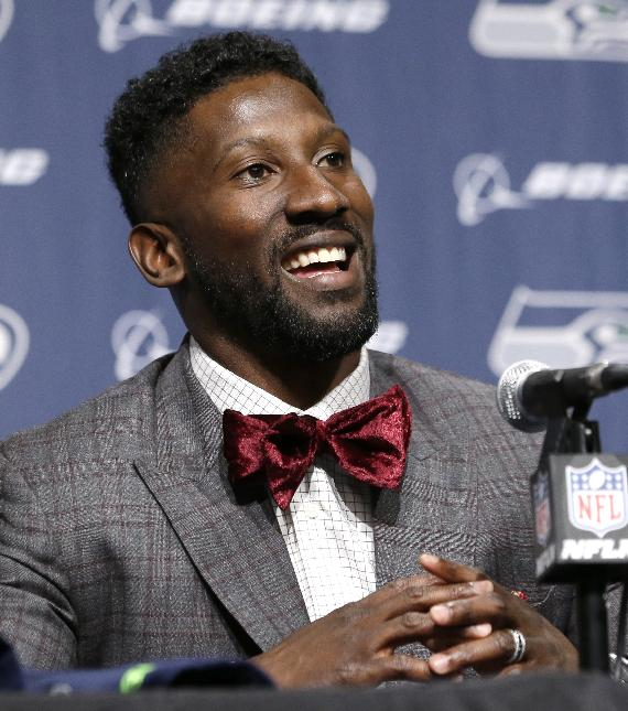 Seattle Seahawks' Marcus Trufant smiles during a news conference announcing his retirement from football after signing with the team a day earlier, Thursday, April 24, 2014, in Renton, Wash. Trufant started 125 games in a Seattle career that lasted from 2003 to 2012. The cornerback was a first-round pick in 2003 out of Washington State and immediately moved into the starting lineup, playing a key role on the 2005 team that advanced to the franchise's first Super Bowl