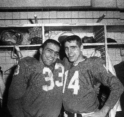 In this Dec. 18, 1960 file photo, Detroit Lions fullback Nick Pietrosante (33) and quarterback Earl Morrall smile in the dressing room after beating the Chicago Bears 36-0, in Detroit. Morrall, an NFL quarterback for 21 years who started nine games during the Miami Dolphins' perfect season in 1972, has died at age 79. The Dolphins confirmed Morrall's death Friday, April 25, 2014