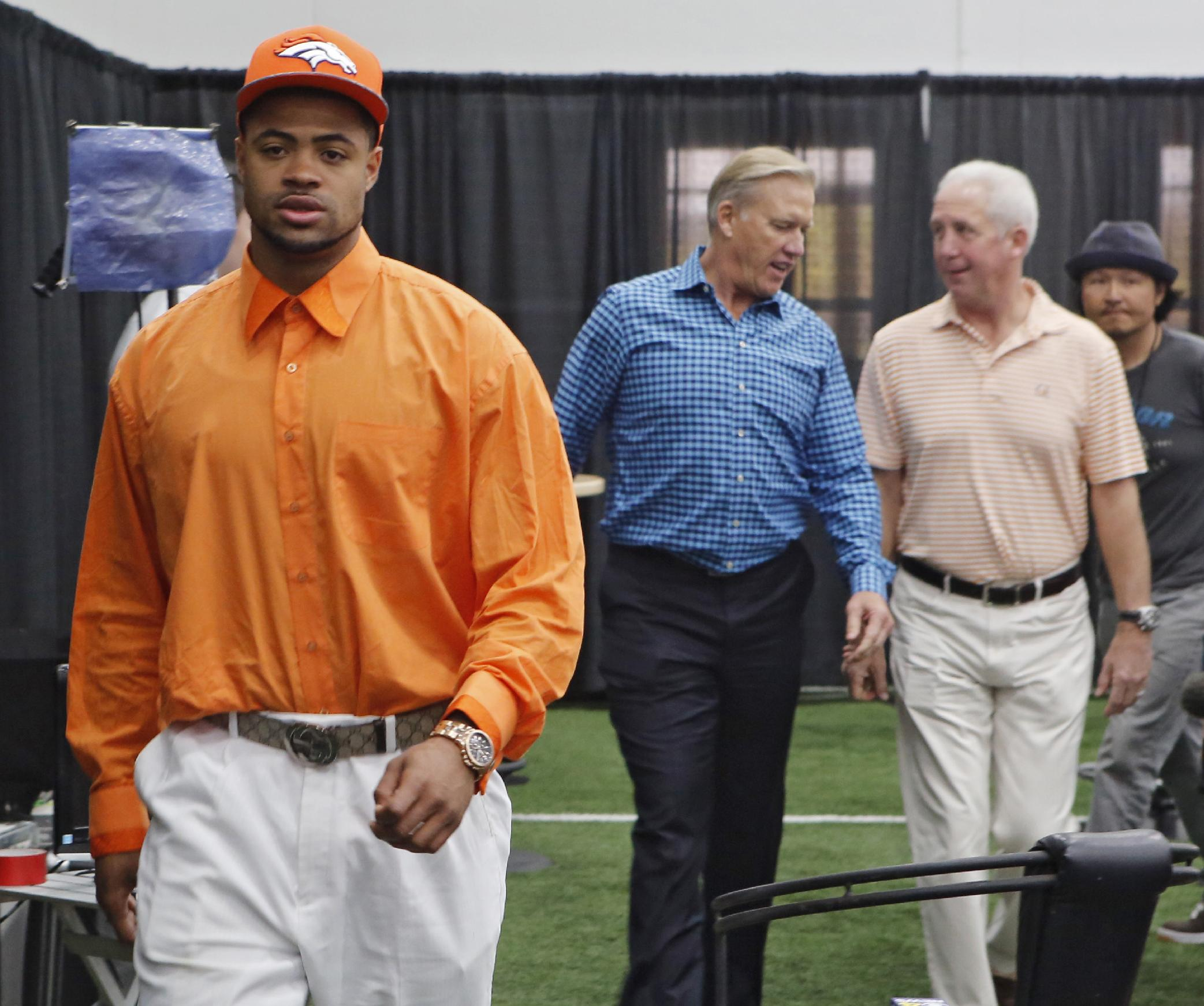 Denver Broncos second round draft pick Indiana wide receiver Cody Latimer, left,  leads the way to a news conference at the NFL football teams headquarters in Englewood, Colo., on Saturday, May 10, 2014.  He is followed by Broncos vice president John Elway, center, and head coach John Fox