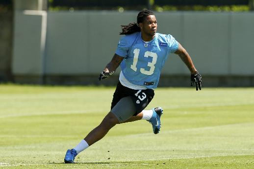 CORRECTS FIRST NAME TO KELVIN, NOT KEVIN - Carolina Panthers' Kelvin Benjamin (13) looks to catch a pass during NFL football rookie camp in Charlotte, N.C., Friday, May 16, 2014