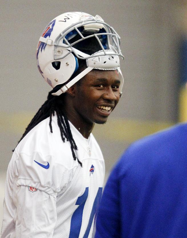 Buffalo Bills first-round draft pick Sammy Watkins smiles after taking part in drills during their NFL football rookie camp at the team's facility, Saturday, May 17, 2014, in Orchard Park, N.Y