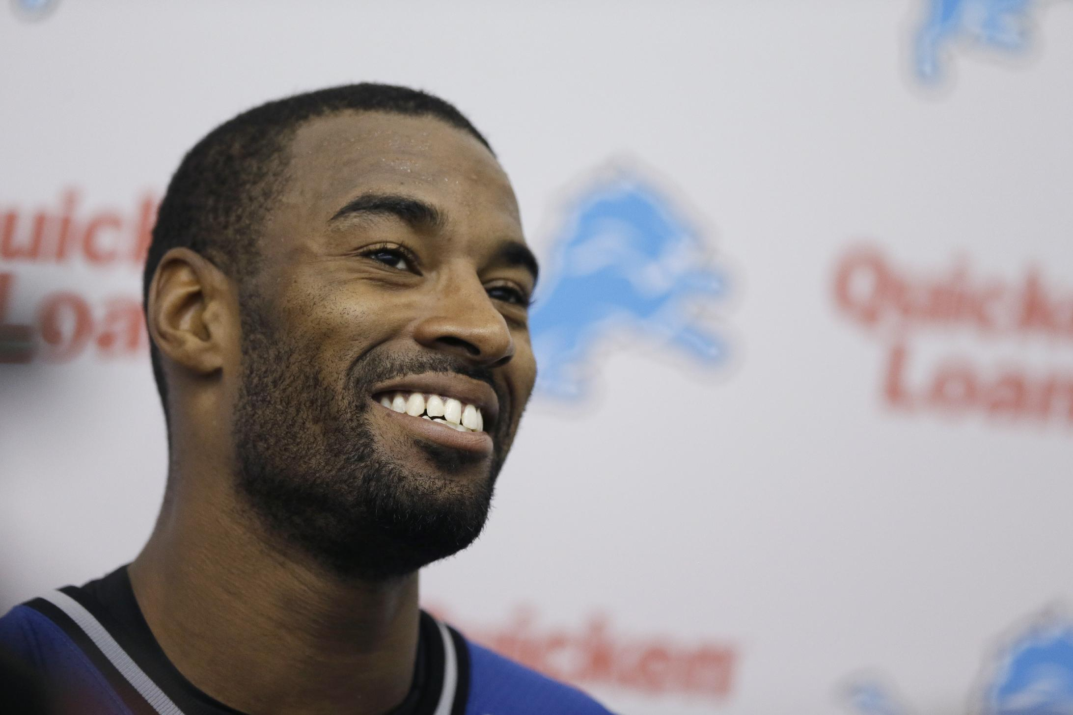 In this May 28, 2014, file photo, Detroit Lions receiver Calvin Johnson talks with the media after an NFL football organized team activity in Allen Park, Mich. Johnson become one of the great players in the history of the Lions, he's also been dependable and durable throughout his career. But toward the end of last season, the bumps and bruises finally seemed to be catching up with the star receiver