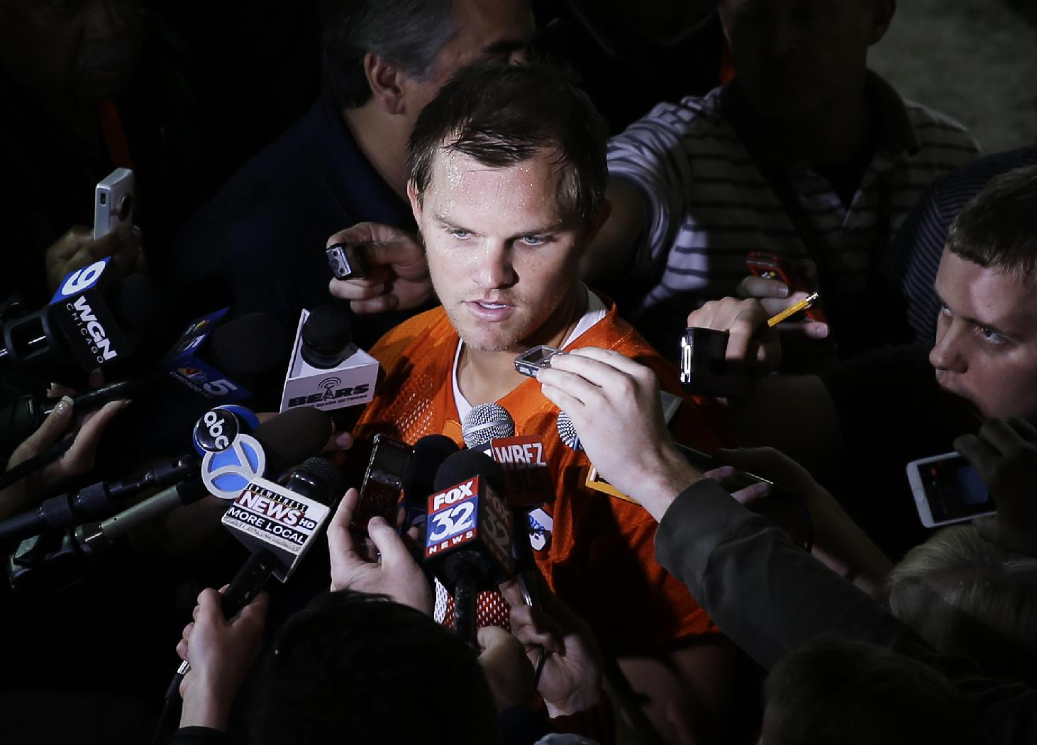 Chicago Bears quarterback Jimmy Clausen  talks to the media after NFL football practice in Lake Forest, Ill., Wednesday, June 11, 2014
