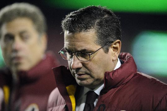 Washington Redskins owner Dan Snyder walks off the field before an NFL football game against the New York Giants Sunday, Dec. 1, 2013, in Landover, Md