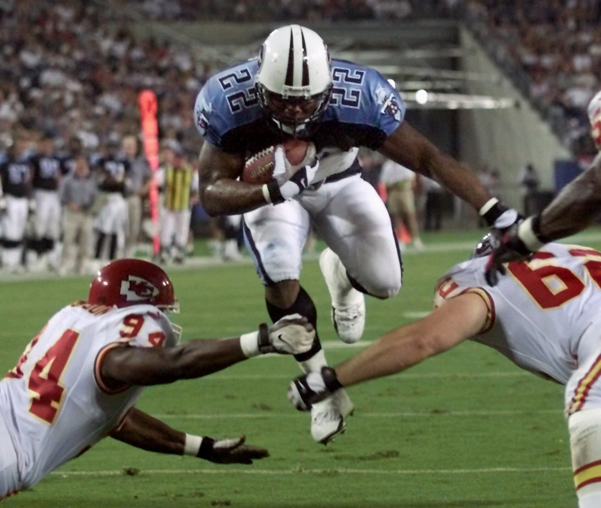 Tennessee Titans running back Rodney Thomas (22) jumps between Kansas City Chiefs defenders Jonathan Jackson (94) and Kevin Sluder (62) to score a touchdown in the second quarter in Nashville, Tenn., on Saturday, Aug. 5, 2000