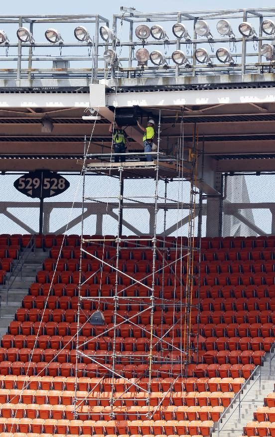 Workers install new speakers during Phase One renovation at FirstEnergy Stadium, Monday, June 16, 2014, in Cleveland. Phase One will add two new video boards, LED video boards and ribbon boards and a completely new audio system