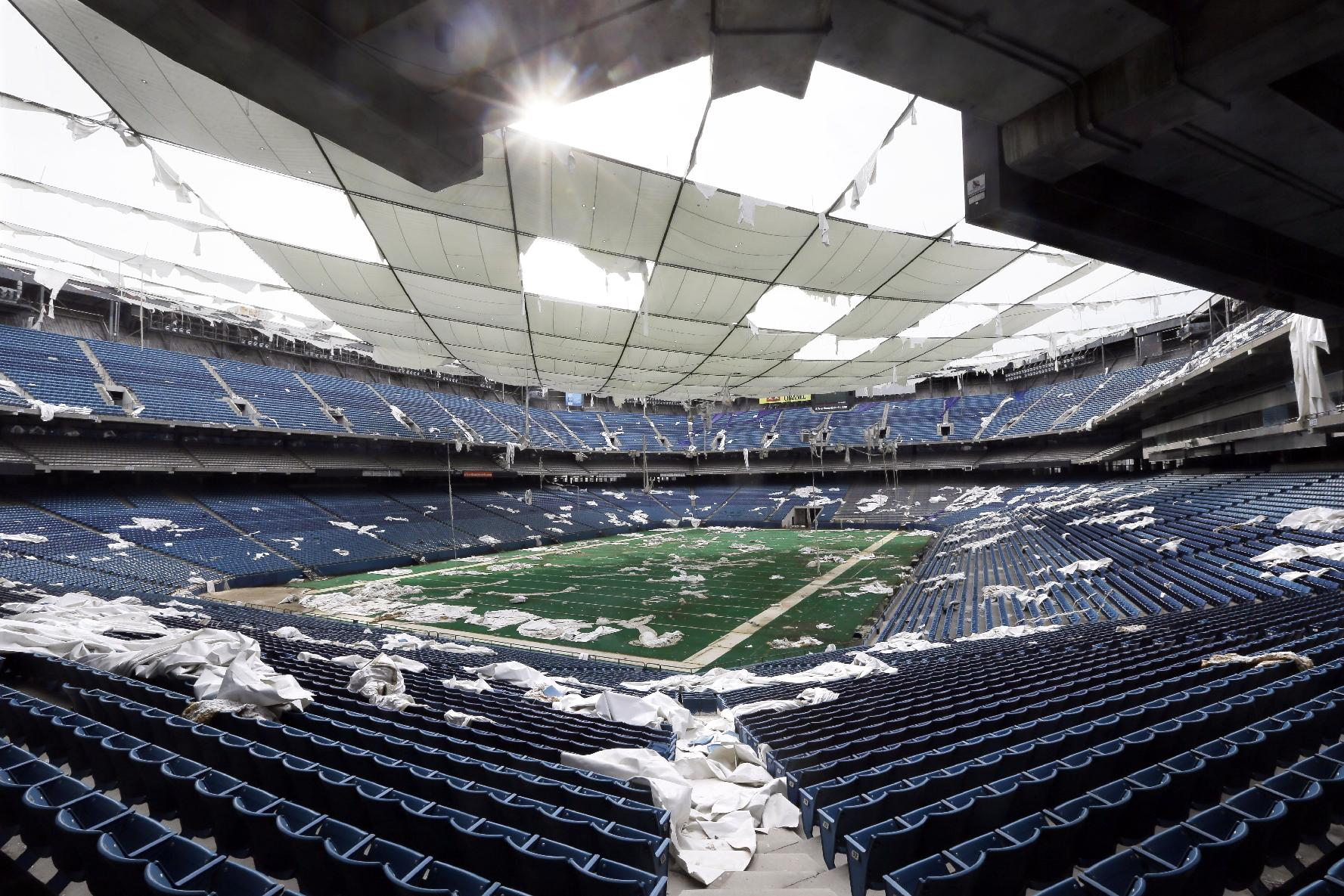 In this May 12, 2014 file photo, the interior of the Pontiac Silverdome, former home of the NFL football Detroit Lions, is seen in Pontiac, Mich. An auction featuring more than 3,000 leftover items in the Pontiac Silverdome has fetched about $500,000. Items up for sale included end-zone turf, pretzel warmers, a boxing ring, a soccer field, flat-screen televisions and scoreboards. The stadium's copper wiring sold for more than $77,000