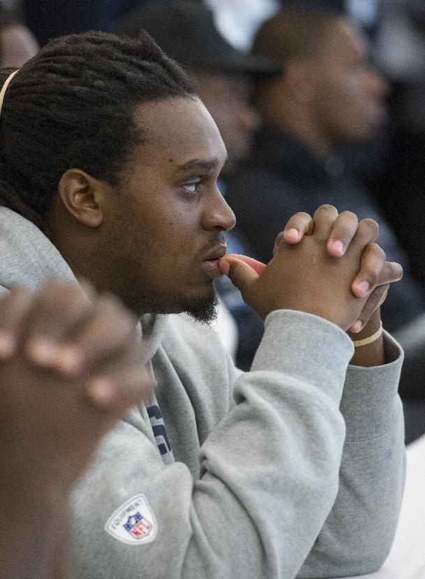 St. Louis Rams rookie Demetrius Rhaney listens to a speech by Pro Football Hall of Fame president David Baker during the 2014 NFL Rookie Symposium at the Pro Football Hall of Fame in Canton, Ohio, Wednesday, June 25, 2014