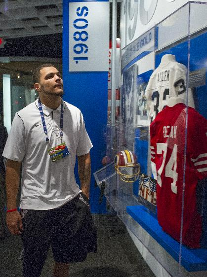 Tampa Bay Buccaneers' rookie Mike Evans looks at 1980's era football displays during the 2014 NFL Rookie Symposium at the Pro Football Hall of Fame in Canton, Ohio, Wednesday, June 25, 2014