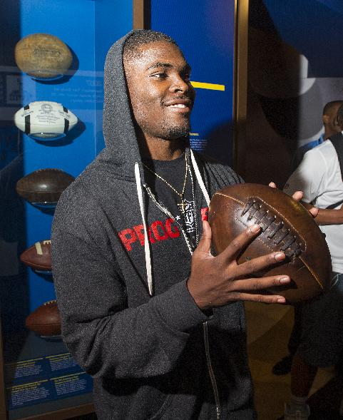 San Francisco 49rs rookie Jimmie Ward plays with a replica of a 1906 football, during the 2014 NFL Rookie Symposium at the Pro Football Hall of Fame in Canton, Ohio, Wednesday, June 25, 2014