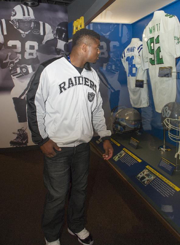 Oakland Raiders rookie Khalil Mack, looks over old uniforms, during the 2014 NFL Rookie Symposium at the Pro Football Hall of Fame in Canton, Ohio, Saturday, June 28, 2014