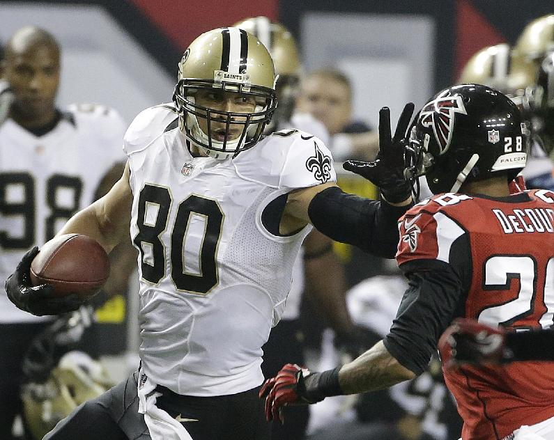 In this Nov. 21, 2013 file photo, New Orleans Saints tight end Jimmy Graham (80) tries to get past Atlanta Falcons free safety Thomas DeCoud (28) during the second half of an NFL football game in Atlanta. An arbitrator has sided with the Saints in ruling that Graham can only be considered a tight end for the purposes of his franchise tag designation. The ruling Wednesday, July 2, 2014, by Stephen Burbank is setback for Graham, agent Jimmy Sexton and the NFL Players Association, who'd filed a grievance arguing that Graham was used as a wide receiver often enough to qualify for the more lucrative receiver tag