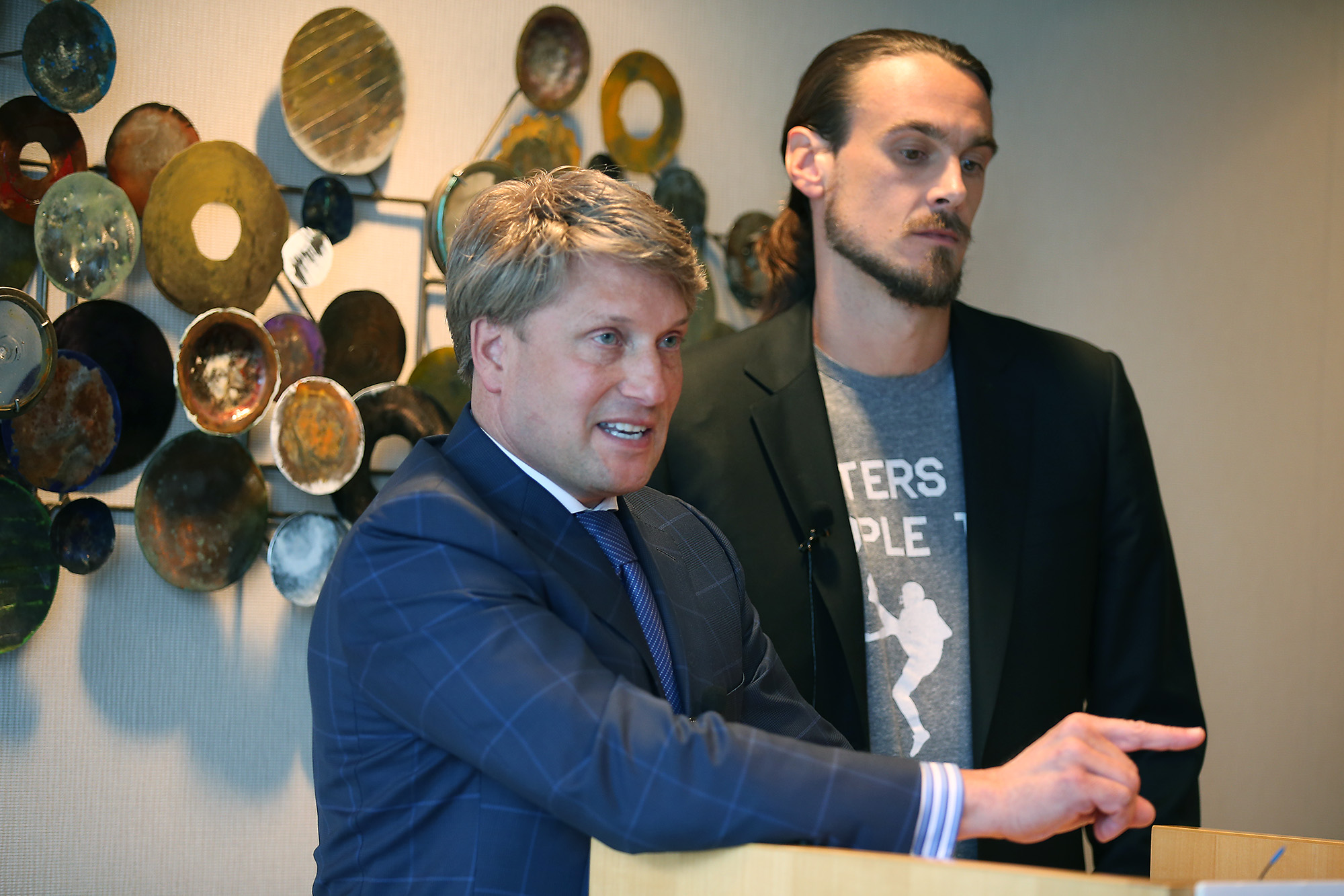 Former Minnesota Vikings punter Chris Kluwe, right, and his attorney Clayton Halunen speak during a press conference, Tuesday, July 15, 2014 in Minneapolis. Former Minnesota Vikings punter Chris Kluwe intends to sue the team over allegations of anti-gay conduct by a coach, his lawyer said Tuesday