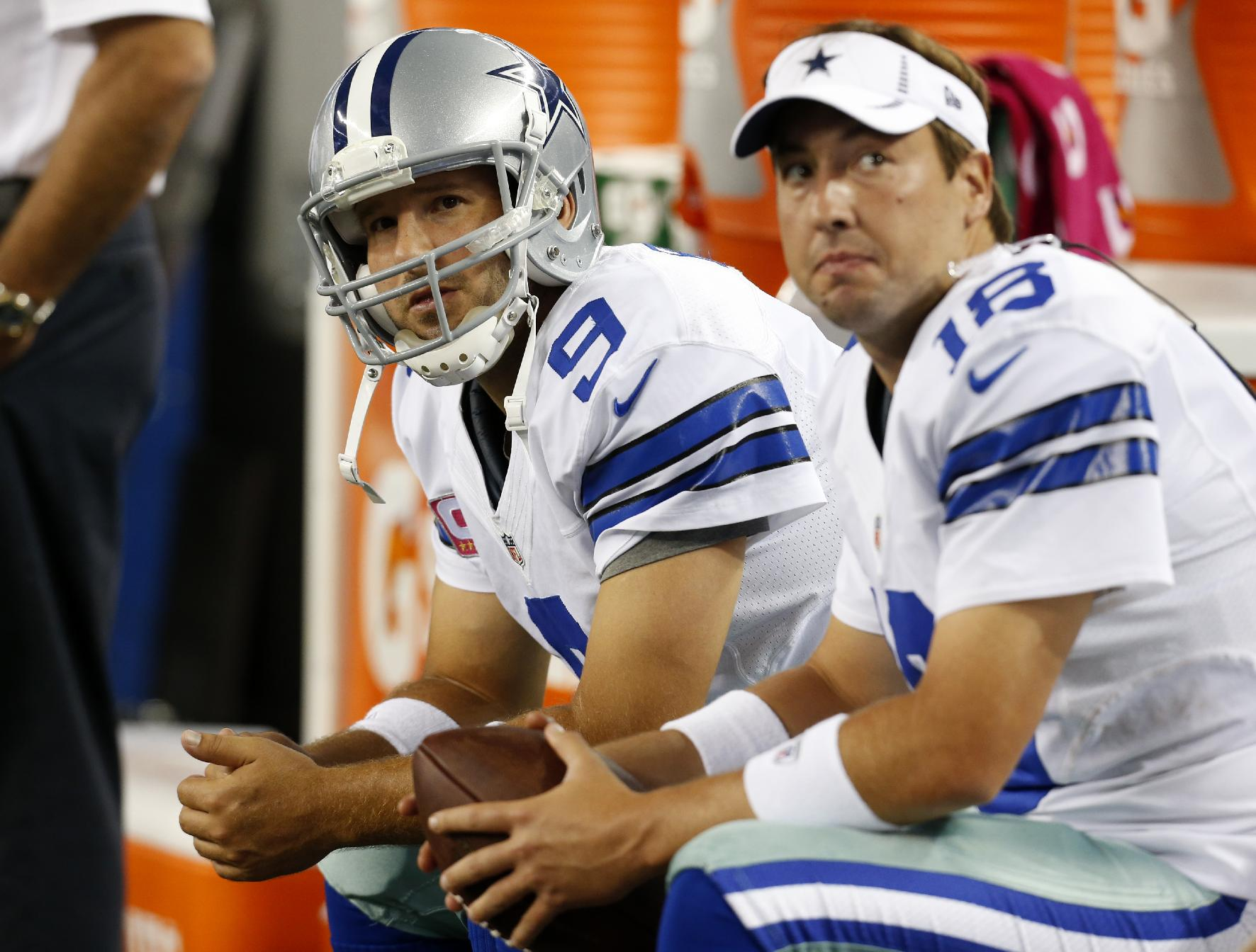 In this Monday Oct. 1, 2012 file photo, Dallas Cowboys' Tony Romo (9) and Kyle Orton (18) sit on the bench during an NFL football game against the Chicago Bears in Arlington, Texas. The Dallas Cowboys are releasing Kyle Orton after their backup quarterback missed all the offseason workouts amid reports that he was considering retirement, Tuesday, July 15, 2014