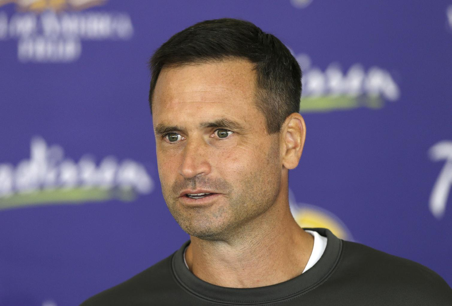 In this July 27, 2013, photo, Minnesota Vikings special teams coordinator Mike Priefer speaks to reporters following practice at NFL football training camp in Mankato, Minn. Former Minnesota punter Chris Kluwe says Priefer made anti-gay comments while Kluwe was with the Vikings. Kluwe wrote a scathing article on the website Deadspin on Thursday, Jan. 2, 2014. In it, he alleges that Priefer made several anti-gay comments in objection to Kluwe's outspoken support of a gay marriage amendment in Minnesota. Kluwe also said coach Leslie Frazier and general manager Rick Spielman encouraged him to tone down his public rhetoric on gay marriage and several other issues. Kluwe was cut last summer and did not play in the NFL this season. The Vikings issued a statement saying they take the allegations seriously. They also say he was released because of his football performance, not something else