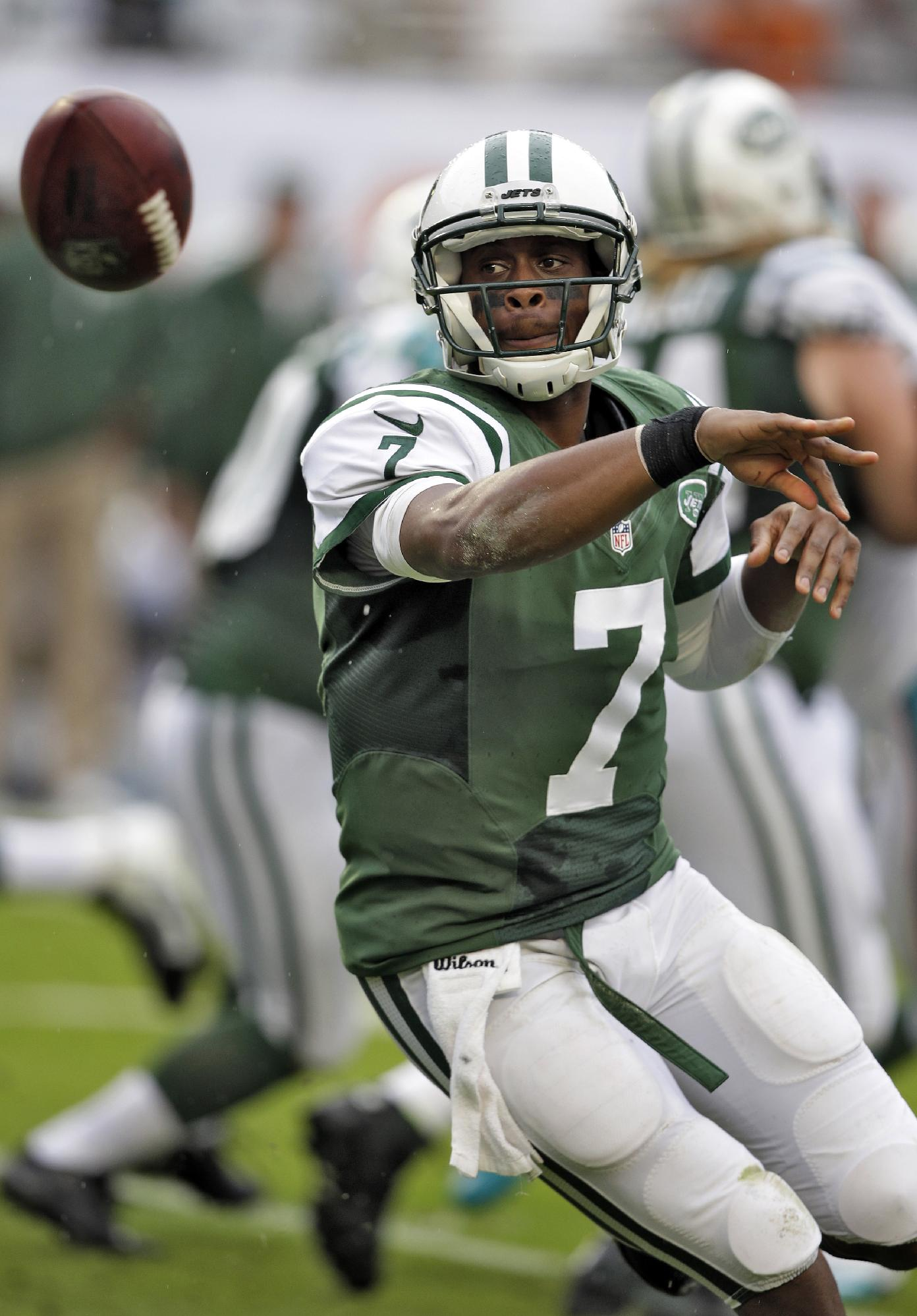 File-This Dec. 29, 2013, file photo shows New York Jets quarterback Geno Smith pitching the ball during the first quarter of an NFL football game against the Miami Dolphins, in Miami Gardens, Fla. Despite having inconsistent rookie quarterback Smith start every game last season and an offense that lacked big-time playmakers, the Jets finished 8-8
