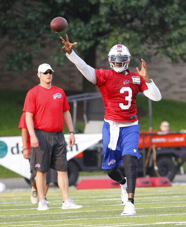 Buffalo Bills quarterback EJ Manuel (3) throws a pass during their NFL football training camp in Pittsford, N.Y., Sunday, July 20, 2014