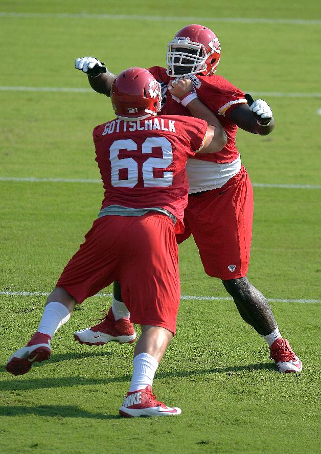 Kansas City Chiefs NFL football center Ben Gottschalk pushes guard Zach Fulton during a drill Monday morning July 21, 2014 on the Missouri Western State University campus in St. Joseph. Mo