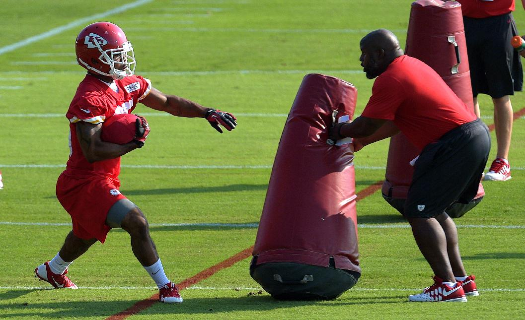 Kansas City Chiefs NFL football running back Charcandrick West sidesteps a blocker during a drill Monday morning July 21, 2014, on the Missouri Western State University campus in St. Joseph. Mo