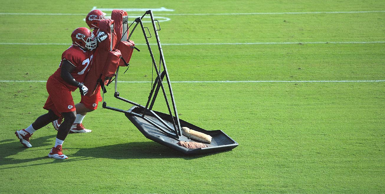 Kansas City Chiefs NFL football lineman Zach Fulton (73), foreground, and Laurent Duvernay-Tardif (76) push a sled during practice Monday morning July 21, 2014, on the Missouri Western State University campus in St. Joseph. Mo