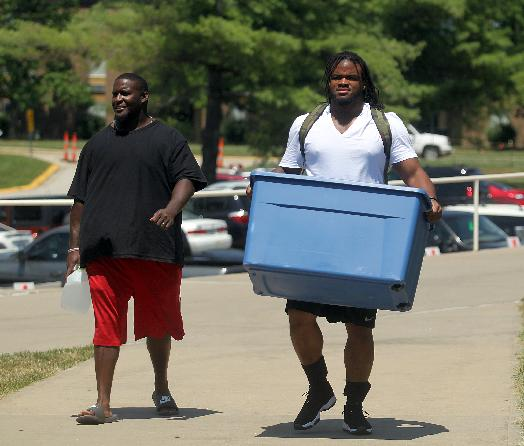Kansas City Chiefs defensive tackle Dontari Poe, right, moves in before NFL football training camp on Wednesday, July 23, 2014, in St. Joeph, Mo