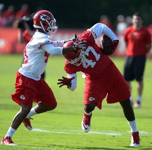 Kansas City Chiefs Malcolm Bronson, left, tries to defend against Demetrius Harris (47) during the NFL team's football training camp Friday, July 25, 2014, in St. Joseph, Mo