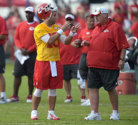 Kansas City Chiefs quarterback Chase Daniel (10) talks with head coach Andy Reid during the NFL team's football training camp Friday, July 25, 2014, in St. Joseph, Mo