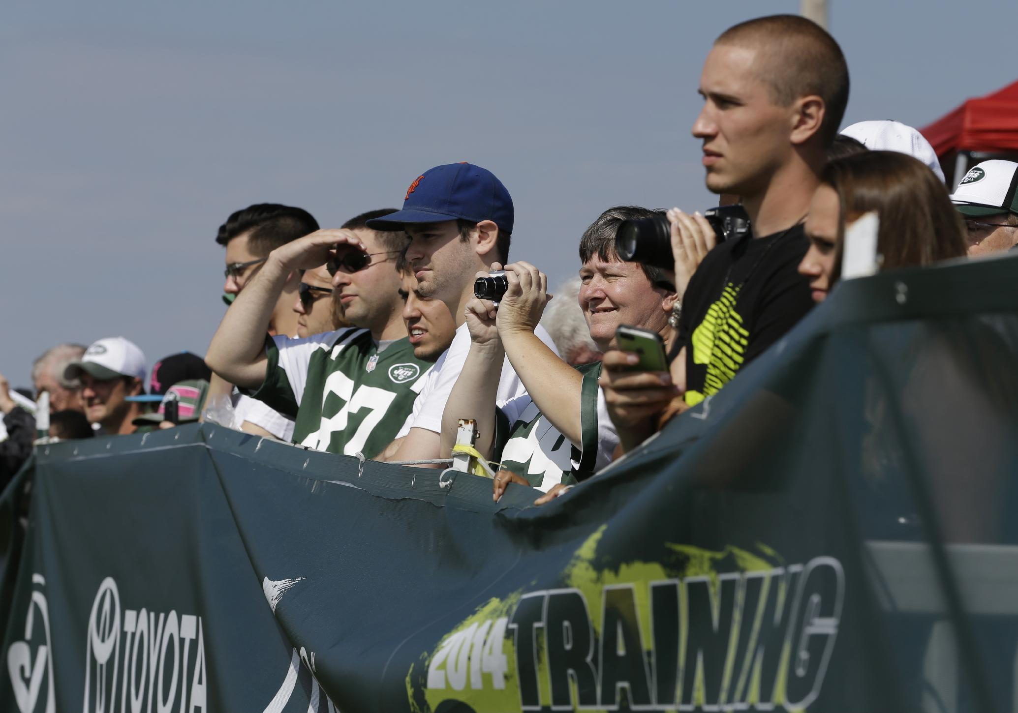 New York Jets fans watch practice during NFL football training camp Saturday, July 26, 2014, in Cortland, N.Y