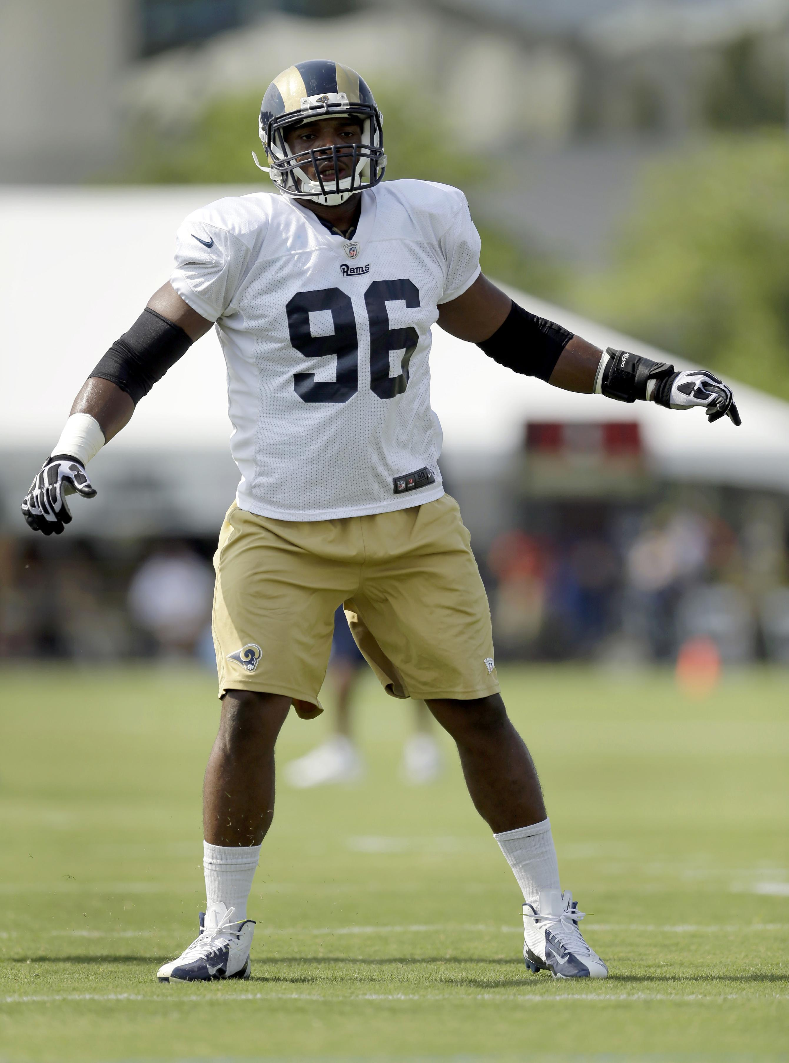 St. Louis Rams defensive end Michael Sam takes part in a drill during training camp at the NFL football team's practice facility Tuesday, July 29, 2014, in St. Louis
