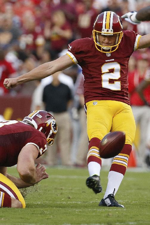 In this Aug. 7, 2014, photo, Washington Redskins kicker Kai Forbath kicks a field goal during the first half of an NFL football preseason game against the New England Patriots in Landover, Md. Robert Griffin III was on the field for 10 plays, and there's really not much to say about any of them. Kai Forbath was on the field for five plays, and they might have cost him his roster spot with the Redskins