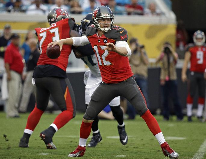 Tampa Bay Buccaneers quarterback Josh McCown (12) throws a pass during the first half of an NFL preseason football game against the Jacksonville Jaguars in Jacksonville, Fla., Friday, Aug. 8, 2014