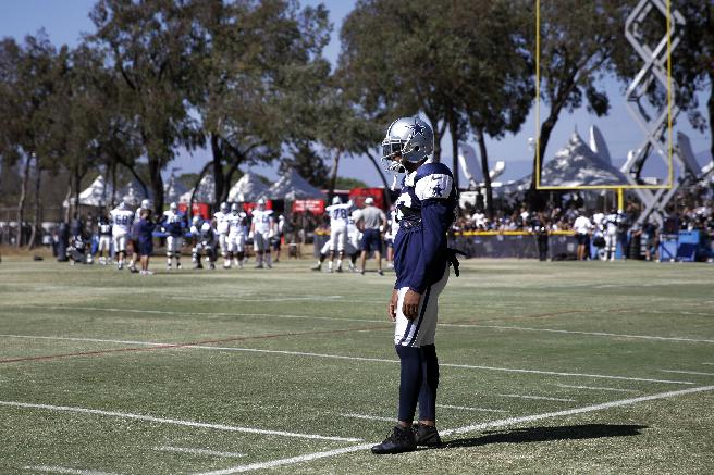 Dallas Cowboys cornerback Orlando Scandrick stands on the field during a football practice with the Oakland Raiders on Tuesday, Aug. 12, 2014, in Oxnard, Calif. Scandrick has apologized to his family, teammates and organization for failing a drug test that will force him to be suspended for the first four games of the season. The NFL announced the suspension on Tuesday