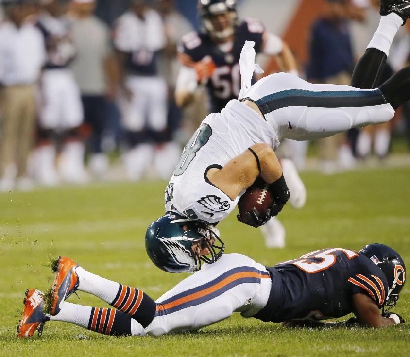 10ThingstoSeeSports - Philadelphia Eagles tight end Zach Ertz, top, collides with Chicago Bears strong safety Brock Vereen after making a catch during the first half of an NFL preseason football game Friday, Aug. 8, 2014, in Chicago