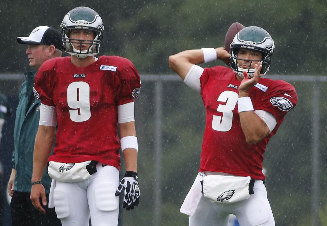 Philadelphia Eagles quarterback Nick Foles (9) watches as quarterback Mark Sanchez (3) passes the football during an NFL football training camp joint practice of the New England Patriots and the Philadelphia Eagles in Foxborough, Mass., Wednesday, Aug. 13, 2014