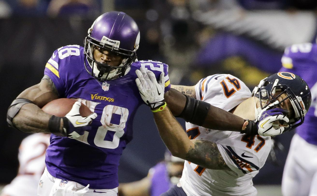 In this Dec. 1, 2013, file photo, Minnesota Vikings running back Adrian Peterson, left, tries to break a tackle from Chicago Bears free safety Chris Conte during the fourth quarter of an NFL football game in Minneapolis. Long before quarterbacks took center stage, the NFL was a running backs league. From Red Grange to Jim Brown to O.J. Simpson to Walter Payton to Emmitt Smith, the workhorse back has been a symbol of toughness and perseverance