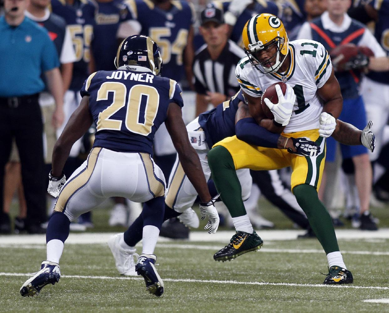 Green Bay Packers wide receiver Jarrett Boykin, right, catches a pass for a 7-yard gain as St. Louis Rams cornerback Lamarcus Joyner (20) defends during the first quarter of an NFL preseason football game Saturday, Aug. 16, 2014, in St. Louis
